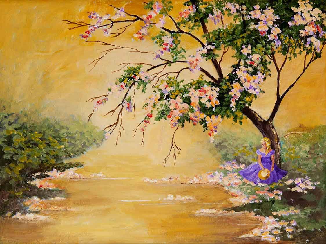 Südliche Schönheit, die unter einem großen blühenden Baum sitzt.